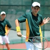 Oliver Anderson (R) and Scott Jones in doubles action at the World Junior Tennis Competition; Wee Photography