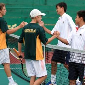 Oliver Anderson (L) and Scott Jones shake hands with the Chinese Taipei doubles combination in the semifinals of the World Junior Tennis Competition in Kuching, Malaysia; Wee Photography
