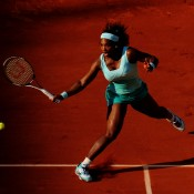 Serena Williams advances on the net during her first round match against Frenchwoman Virginie Razzano, the final match of Day 3 on Court Phillipe Chatrier. Williams led by a set and 5-1 in the second set tiebreak before things started to unravel; Getty Images
