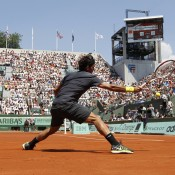 World No.3 Roger Federer swats a forehand back in his match against German Tobias Kamke on Court Suzanne Lenglen during Day 2 of the French Open, which he won 6-2 7-5 6-3; Getty Images