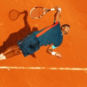 French fifth seed Jo-Wilfried Tsonga stretches for a serve beneath sunny skies on Day 1 at the 2012 French Open. After dropping the opening set, Tsonga came back to defeat Russia's Andrey Kuznetsov 1-6 6-3 6-2 6-4; Getty Images