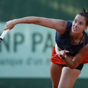 Australia's Jarmila Gajdosova serves Magdalena Rybarikova in their first round match on Day 3 at Roland Garros. Gajdosova advanced to round two when Rybarikova retired down 6-3 4-1 due to a back injury; Getty Images