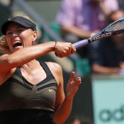 No.2 seed Maria Sharapova shows off her devastating power during a 6-0 6-0 demolition of Romania's Alexandra Cadantu in her first round match on Court Suzanne Lenglen on Day 3 of the French Open; Getty Images