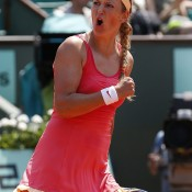 World No.1 Victoria Azarenka celebrates after claiming a hard fought victory over Italian Alberta Brianti. Azarenka was down a set and 4-0 before recovering to post a 6-7(6) 6-4 6-2 win on Court Philippe Chatrier; Getty Images