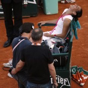 France's Virginie Razzano is overwhelmed with delight after her 4-6 7-6(5) 6-3 victory over Serena Williams before a boisterous crowd on Court Philippe Chatrier, smiling in her chair after creating one of the biggest upsets in Grand Slam history; Getty Images