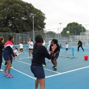 Evonne Goolagong Cawley (fifth from left) warms up along with other Indigenous participants at the Tennis Come and Try Day in Sydney as part of the Learn Earn Legend! initiative; Tennis Australia