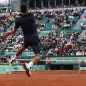 Novak Djokovic hits a return against Rafael Nadal during their French Open men's final at Roland Garros; Getty Images