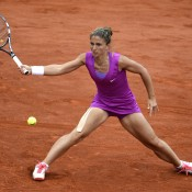 Sara Errani stretches to play a forehand during the French Open women's final against Marisa Sharapova at Roland Garros; Getty Images