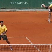 Australia's Andrew Harris (R) serves alongside doubles partner Nick Krygios in the boys' doubles final at Roland Garros; Getty Images