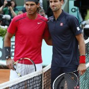 Serbia's Novak Djokovic (R) and Spain's Rafael Nadal pose for photographs prior to their French Open men's final match at Roland Garros; Getty Images