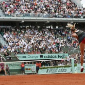 Maria Sharapova serves to Sara Errani during the French Open women's singles final at Roland Garros in Paris; Getty Images