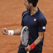 Despite falling into a precarious position in the French Open final, Djokovic kept his hopes alive by reeling off eight consecutive games to wrench the third set from Nadal's grasp and move ahead a break in the fourth; Getty Images