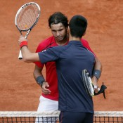 Rafael Nadal (L) and Novak Djokovic embrace after their dramatic French Open final, which Nadal won 6-4 6-3 2-6 7-5; Getty Images