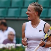 Russia's Svetlana Kuznetsova, the 26th seed, celebrates after a resounding 6-1 6-2 upset victory over world No.3 Agnieszka Radwanska in the third round of the 2012 French Open; Getty Images