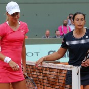 Petra Martic (L) shakes hands with Marion Bartoli after sending the Frenchwoman out of the French Open thanks to a 6-2 3-6 6-3 victory; Getty Images