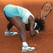 Fifth seed Serena Williams reacts after losing a point during her dramatic first round match against France's Virginie Razzano at the French Open on an atmospheric Court Philippe Chatrier; Getty Images