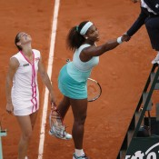 Razzano contemplates the magnitude of her achievement as Williams shakes hands with umpire Eva Asderaki following their epic first round match at Roland Garros; Getty Images