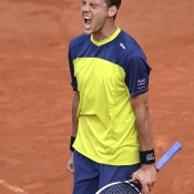 France's Paul-Henri Mathieu celebrated a titanic victory over 10th seed John Isner, with the wildcard winning 18-16 in the fifth set after five hours and 41 minutes before a rapturous French crowd; Getty Images