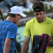Bright colours again reigned supreme in the men's fourth round, shown here in the match between seventh seed Tomas Berdych (L) and Juan Martin Del Potro, seeded 9th; Getty Images