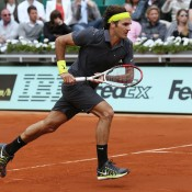 Roger Federer looks typically sleek and stylish in charcoal attire, highlighted by lime-green touches; Getty Images
