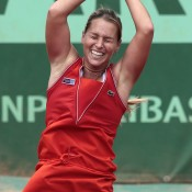 Unfortunately for Azarenka, the fashion tactic didn't work, as she was ousted by Slovakian Dominika Cibulkova in straight sets. Cibulkova has been competing in a vibrant red Lacoste number during this year's French Open; Getty Images