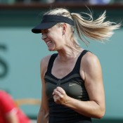 Maria Sharapova urges herself on during her semifinal win against Petra Kvitova at Roland Garros; Getty Images
