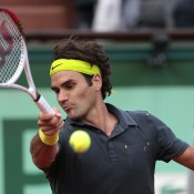 Switzerland's Roger Federer hits a return during his semifinal loss to Novak Djokovic at the French Open; Getty Images