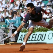 World No.1 Novak Djokovic stretches for a ball during his straight set victory over Roger Federer in the French Open semifinals on Friday; Getty Images
