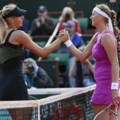 Russia's Maria Sharapova (L) shakes hands with Petra Kvitova of the Czech Republic, following Sharapova's 6-3 6-3 win in the French Open semifinals; Getty Images