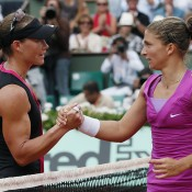 Italy's Sara Errani (R) shakes hands with Sam Stosur of Australia following Errani's win in the French Open semifinals; Getty Images