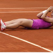 Sara Errani collapses to the court in disbelief following her 7-5 1-6 6-3 win over Sam Stosur, her first win over the Australian sending her through to her first career Slam final; Getty Images