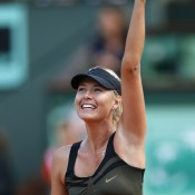 A delighted Maria Sharapova waves to the crowd on Court Philippe Chatrier after winning through to the French Open final in Paris; Getty Images