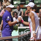 Australia's Samantha Stosur (R) shakes hands with Britain's Elena Baltacha after winning their Women's Singles 1st Round tennis match of the French Open tennis tournament at the Roland Garros stadium, on May 27, 2012 in Paris; Getty Images