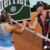 Australia's Samantha Stosur (R) shakes hands with Irina Falconi during their women's Singles 2nd Round tennis match of the French Open tennis tournament at the Roland Garros stadium, on May 30, 2012 in Paris;Getty Images