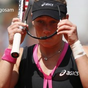 Australia's Samantha Stosur adjusts her glasses as she plays with Slovakia's Dominika Cibulkova during their Women's Singles quarterfinal match of the French Open tennis tournament at Roland Garros on June 5, 2012 in Paris; Getty Images