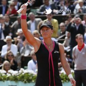 Australia's Samantha Stosur waves to the crowd on Court Philippe Chatrier after defeating Slovakia's Dominika Cibulkova in the women's singles quaterfinal of the French Open at Roland Garros on June 5, 2012 in Paris; Getty Images