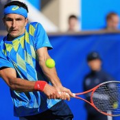 Marinko Matosevic plays a backhand during his first round match against Britain's James Ward at the ATP event in Eastbourne. Having come through qualifying, Matosevic continued his roll with a three-set win over the Brit; Getty Images