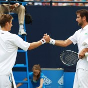 Matthew Ebden (L) shakes hands with sixth seed Marin Cilic after the Croatian defeated Ebden in the second round of the Queens Club event in London. Ebden won his first round match against Matthias Bachinger of Germany; Getty Images