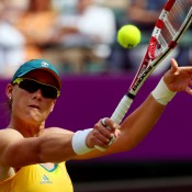 Sam Stosur was Australia's sole representative in the women's singles for Australia, seen here playing a backhand volley in her match against Carla Suarez Navarro of Spain in the first round on Court No.1 at Wimbledon; Getty Images