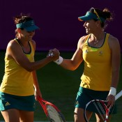 Despite Stosur (right) and Dellacqua losing 6-1 6-1 to the Spaniards, they managed to keep their spirits fairly high on court during the London 2012 tennis event; Getty Images