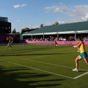 Stosur, pictured playing a backhand, returned to the court following her singles defeat later on Day 1, teaming with Casey Dellacqua in the women's doubles event; Getty Images