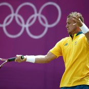 Lleyton Hewitt plays a forehand against Sergiy Stakhovsky of Ukraine on Day 3 of the London 2012 Olympic Games at the All England Lawn Tennis Club; Getty Images
