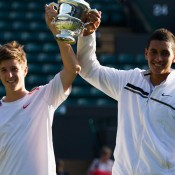 Andrew Harris (L) and Nick Kyrgios hold aloft the Wimbledon boys' doubles trophy after winning the final on Sunday at the All England Club; Getty Images