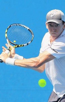 MELBOURNE, AUSTRALIA - DECEMBER 15:  John-Patrick Smith of Australia plays a backhand in his first round match against Jacob Grills of Australia during the 2015 Australian Open play off at Melbourne Park on December 15, 2014 in Melbourne, Australia.  (Photo by Robert Prezioso/Getty Images)