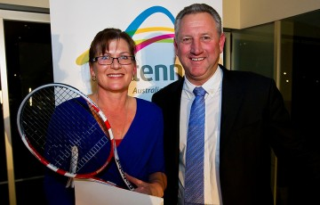 Senator the Honourable Kate Lundy, Minister for Sport, Minister for Multicultural Affairs, Minister Assisting for Industry and Innovation receives a tennis racquet signed by Samantha Stosur from Tennis Australia CEO Steve Wood at the 2012 Australian Tennis Conference. Mark Riedy.