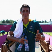 Bernard Tomic gives a thumbs-up after a practice session with Lleyton Hewitt ahead of the 2012 London Olympic Games at Wimbledon; Getty Images