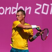 Lleyton Hewitt plays a forehand in a practice session ahead of the 2012 London Olympic Games at Wimbledon; Getty Images