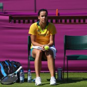 Jarmila Gajdosova takes a break during practice at the All England Lawn Tennis Club in Wimbledon ahead of the London 2012 Games; Getty Images