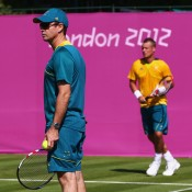Head of Professional Tennis Todd Woodbridge oversees Lleyton Hewitt's practice session ahead of the 2012 London Olympic Games at the All England Lawn Tennis Club in Wimbledon; Getty Images