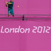 Amid a snapshot of the colour that will adorn the All England Club during the Olympic tennis event, Bernard Tomic plays a backhand in practice ahead of the 2012 London Olympic Games at Wimbledon; Getty Images